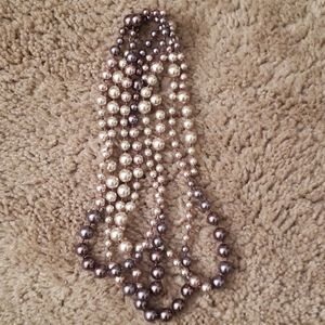 Very long strand of pearls